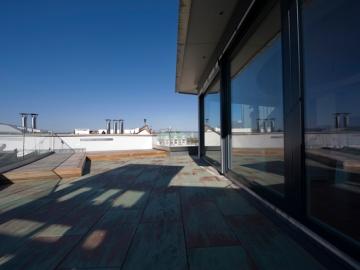 Portalverglasung mit Holz/Alu Fenster aus eigener Produktion