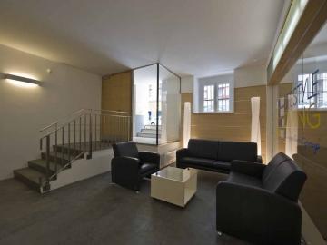 Designeingangsbereich mit Holz Wandverbau